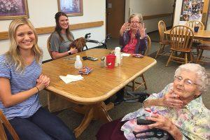 Clients and employee at a table at rosholt countryside inn