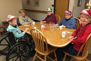 A group of women wearing hats at rosholt countryside inn